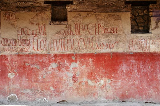 Roman-graffiti-on-building-